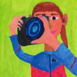 「女性カメラマン」 伊東 大悠(吉島小4年)  ●第7回 国際ソロプチミスト「夢を生きる」アートコンテスト・奨励賞